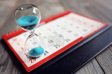 Hour glass on calendar concept