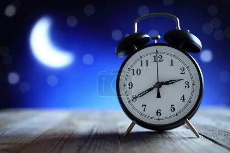 Photo for Alarm clock in the middle of the night insomnia or dreaming - Royalty Free Image