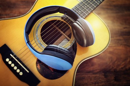 Photo for Guitar and headphones concept for listening to music or recording studio equipment - Royalty Free Image