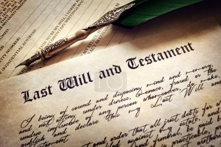 Testament document with quill pen