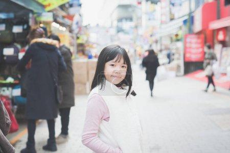 Beautiful Asian girl walking in the city