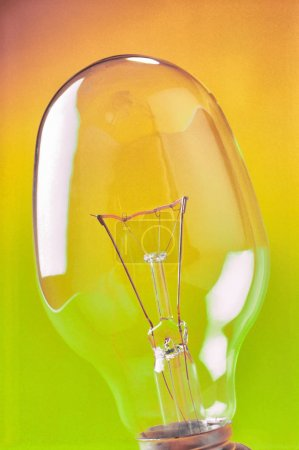 Photo for Glass transparent incandescent lamp for lighting, close-up. Industrial product. - Royalty Free Image