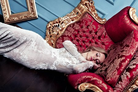 Fashion model posing in the chair