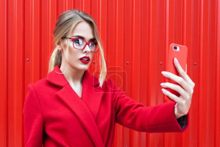 blonde woman taking selfie