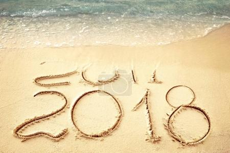 New Year 2018 replace 2017 on sea beach summer, New Year 2017 is