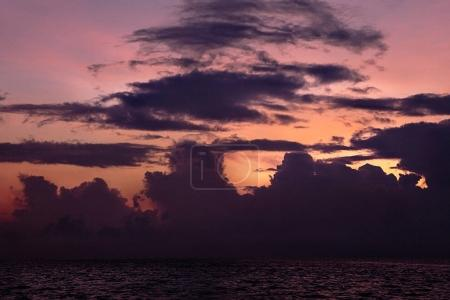 beautiful tropical sunset, clouds in many colors in Maldives