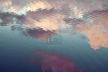 Photo for Reflection of blue sky with white clouds in water, abstract background. - Royalty Free Image