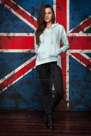 Photo for Full Length Portrait of Trendy Hipster Girl Standing at the Dark Brick Wall Background. Urban Fashion Concept - Royalty Free Image