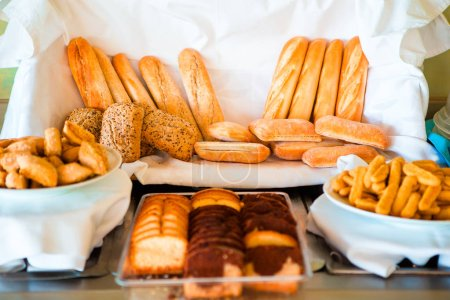 Different sorts of bread on breakfast in cafe