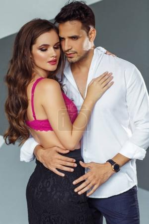 beautiful young couple posing in studio