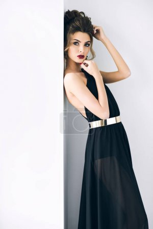 beautiful woman with hairstyle in elegant black dress