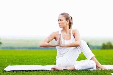 portrait of young healthy woman meditating outdoor