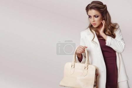 Photo for Fashion portrait of young beautiful woman wearing stylish clothes over grey background - Royalty Free Image