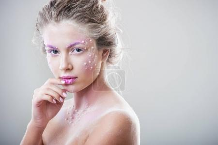 fashion portrait of young beautiful woman with winter fantasy makeup