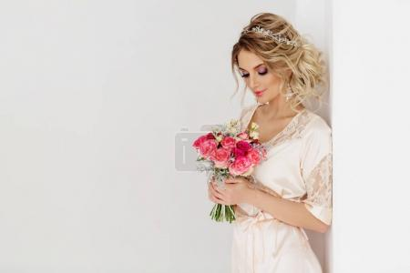 beautiful young woman in lingerie posing with bouquet