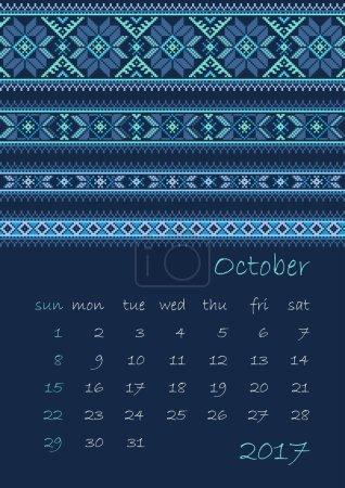 2017 Calendar planner with ethnic cross-stitch ornament on dark blue background Week starts on Sunday