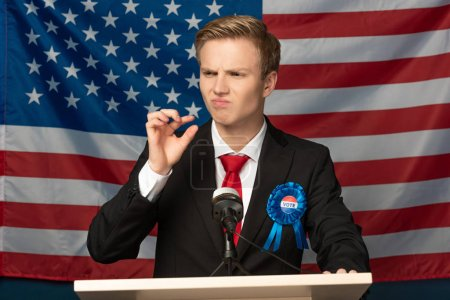 Photo for Displeased man on tribune on american flag background - Royalty Free Image