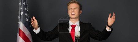 Photo pour Happy emotional man with american flag on black background - image libre de droit
