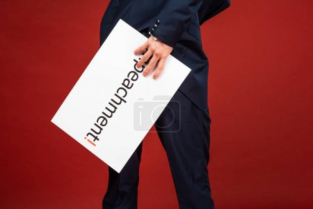 Photo pour Cropped view of man holding white card with impeachment lettering on red background - image libre de droit