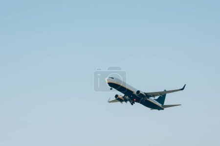 Flight departure of airplane in blue sky with copy space