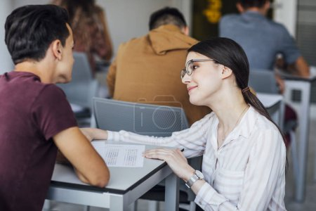 Teacher Helping Student on Exam