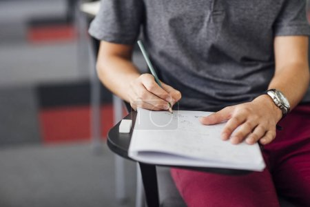 Male Student Taking Notes