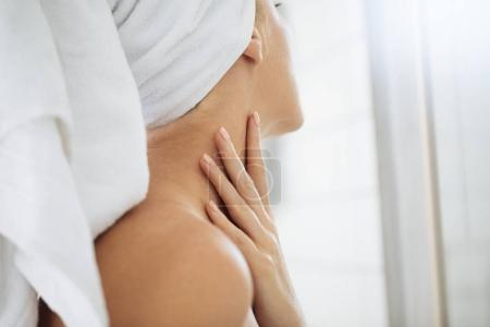 Woman Touching Her Neck