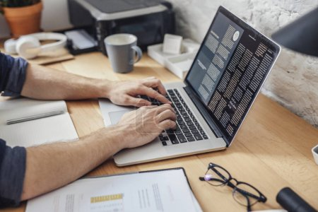Photo for Hands of cropped unrecognisable man typing on his laptop at office. - Royalty Free Image