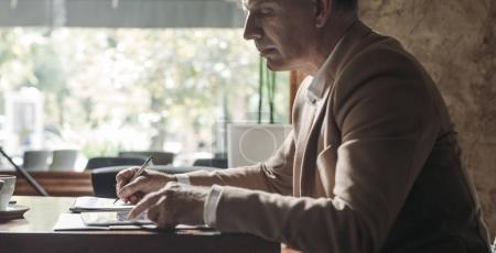 Elegant Businessman Writing