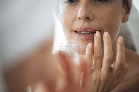 Woman Touching Her Lips