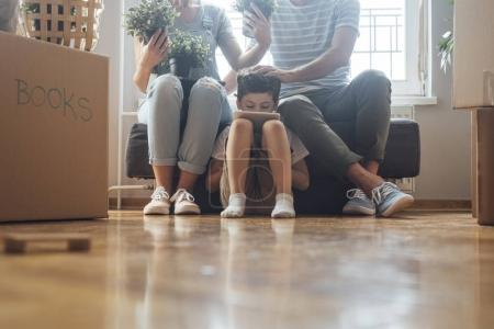 Photo for Husband and wife and their son moving in new home. - Royalty Free Image