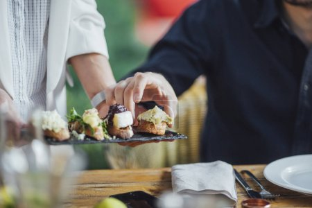 Woman Dinner Party Host Serving Food to Her Friends