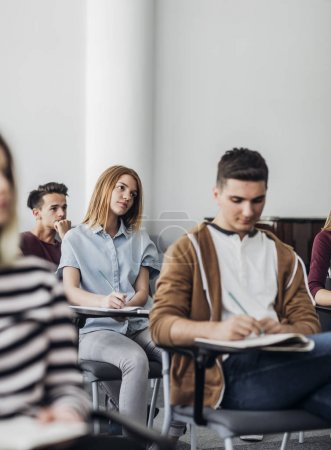Students Taking Notes at Class