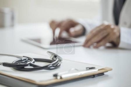 Physician Working at His Office