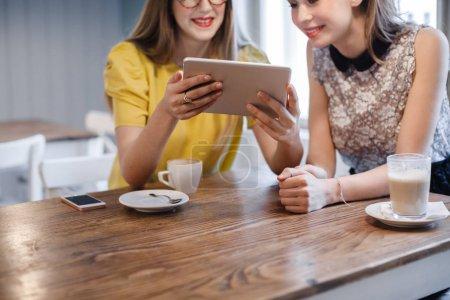Girlfriends Using Tablet