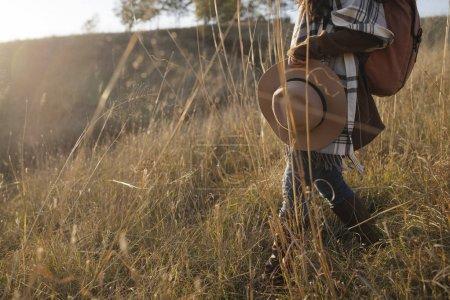 Woman Trekking in The Field