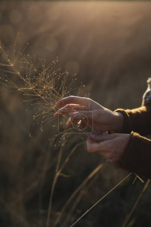 Woman Holding Grass