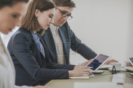 Photo for Group of businessmen and businesswomen  working together at office. - Royalty Free Image