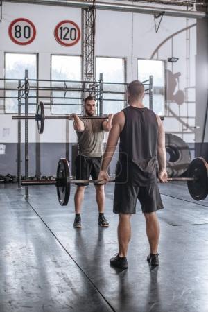 Sportsmen Lifting Weights