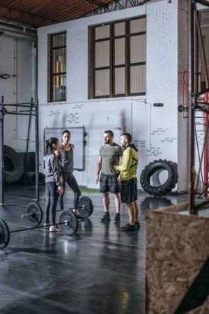 Sportsmen and Sportswomen Talking at Gym