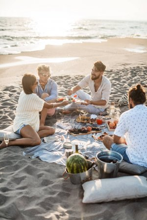 People Enjoying Food on Beach Picnic