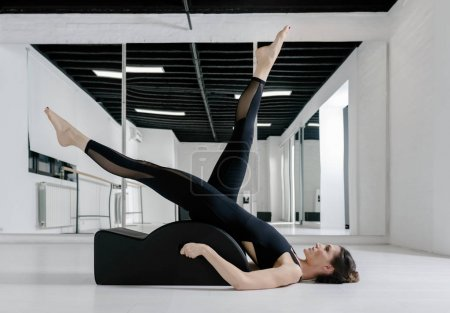 A Woman Doing Pilates Exercise