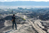 Man on top of Layer Volcanic ash as sand ground of Mount Bromo v