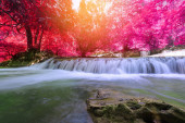 Waterfall in deep rain forest jungle (Thung Nang Khruan Waterfal