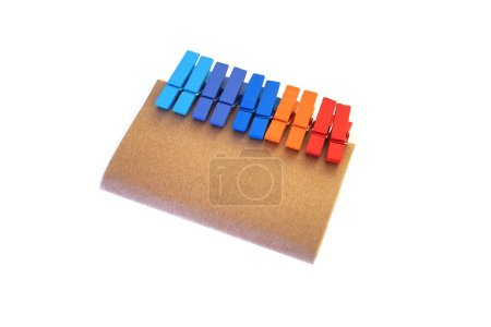 Brown paper and colorful clamp with copy space
