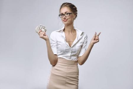 A business lady in glasses and white shirt holds a...