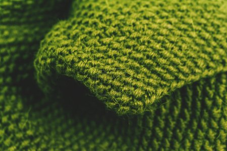 Photo for Knitted green wool textile close-up - Royalty Free Image