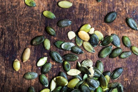 Photo for Green Pumpkin seeds background top view image - Royalty Free Image