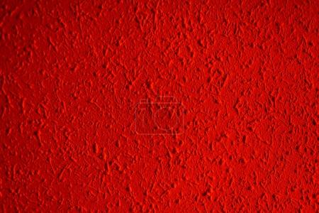Closeup of red color grunge textured wall