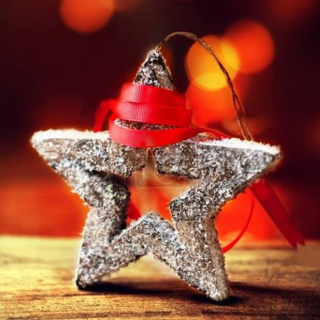 Festive star and red ribbon
